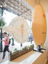 People walk past the Innerlight Surf Shop's new location