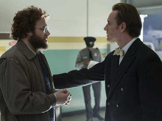 """Seth Rogen and Michael Fassbender, right, appear in a scene from """"Steve Jobs."""""""