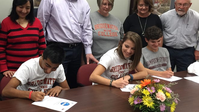 (From left to right) Sonet Ghandi, Jenifer Lantz and Grayson Burns sign commemorative letters of intent on Tuesday, April 28.