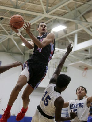 Finneytown's Darius Bazley gets some air on a drive to the basket.