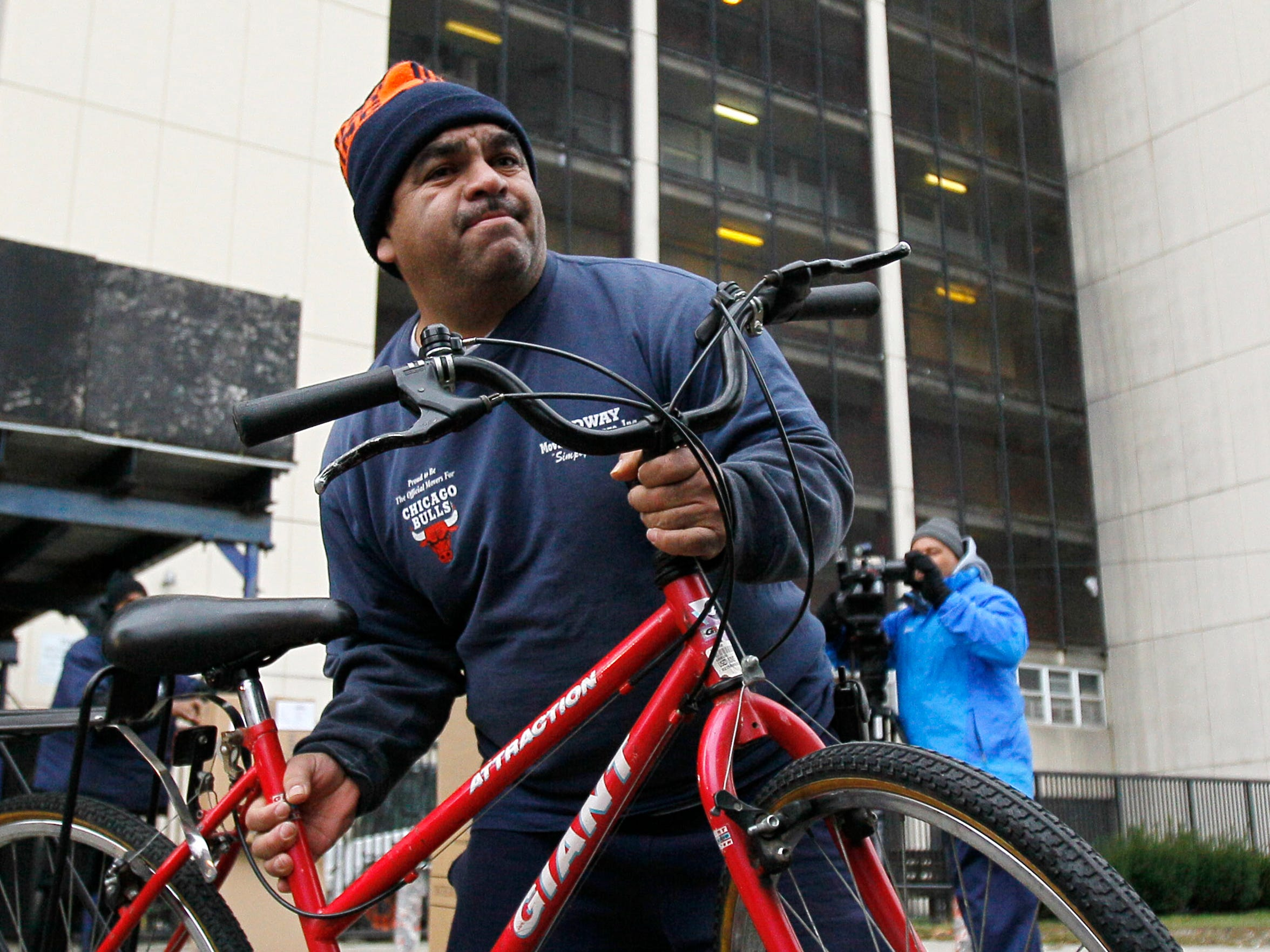 A mover, hired by the Chicago Housing Authority, works