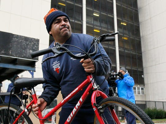 A mover, hired by the Chicago Housing Authority, works on Nov. 30, 2010, at Chicago's Cabrini Green.