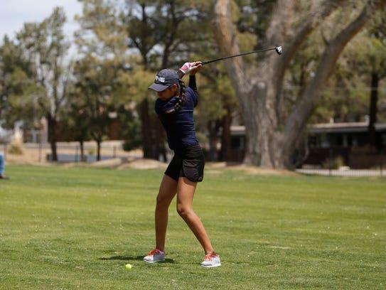 Piedra Vista's Shandiin Harper swings for her second