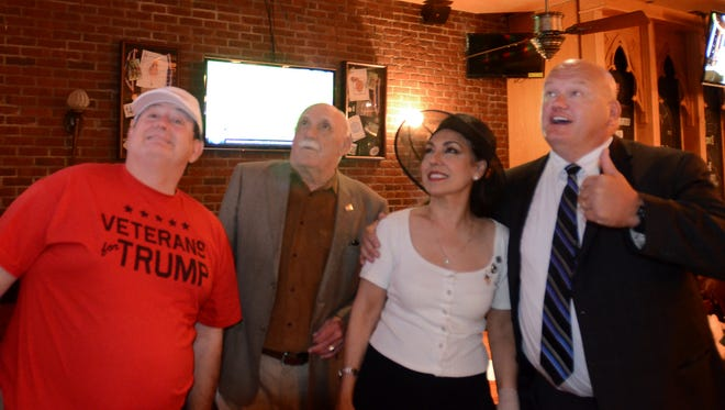 Farmington Area Republicans gather Sept. 26 at Cowley's for the first presidential debate (from left): Mitch Svoboda, Bill Belcher, Siham J. Lecureaux and Mike Goetz.