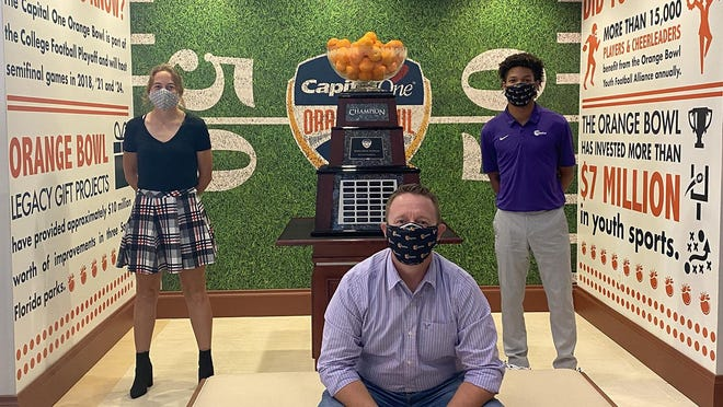 From left: Kensey Arlt, John Mas and Jaylan Lopez. Arlt and Lopez have joined Mas, who has been with the Orange Bowl for 16 years and is now its senior director of partnerships.