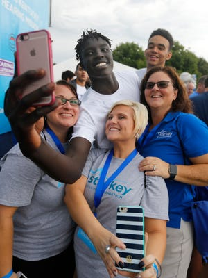 UK baksetball player Wenyen Gabriel took a selfie photo with members of the Starkey Foundation Hearing Mission. The foundation provided approximately one hundred hearing aids to those in need at Whitaker Bank Ballpark, in Lexington. Aug. 28, 2016.