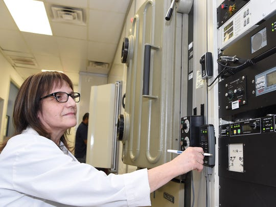 Noly Trillo, a coating technician, operates machinery at Spectral Systems in Hopewell Junction.