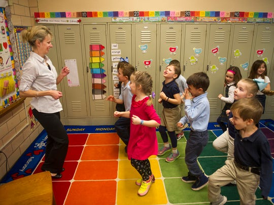 Mary Goedde, a kindergarten teacher at Saint Benedict Catholic School, keeps her students busy with both body and mind during her morning class session.