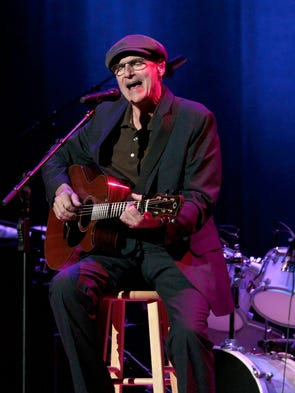 James Taylor performs with Steve Gadd and his band.