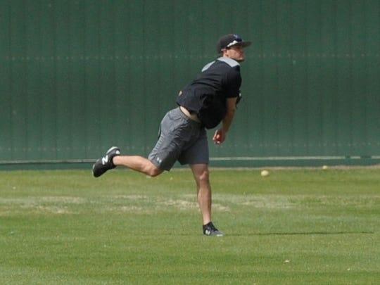 Hardin-Simmons center fielder Hunter Garrison throws