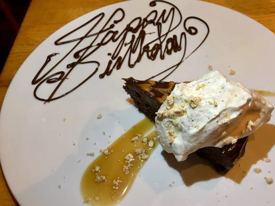 The chocolate and peanut butter flourless torte at the Fat Snook arrived at the table with a Happy Birthday message.