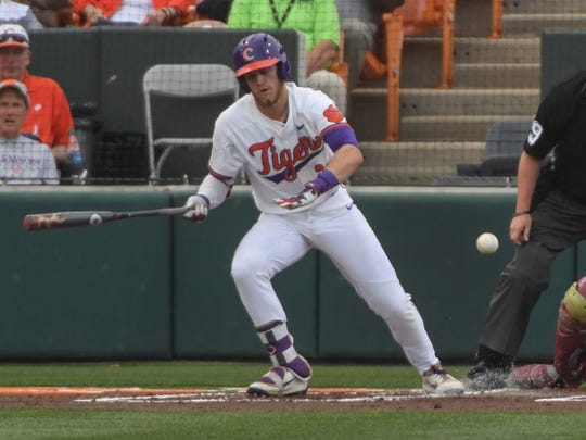 Clemson junior first baseman Seth Beer (28) hits a ball against Florida State during the bottom of the first inning on Monday at Doug Kingsmore Stadium in Clemson.