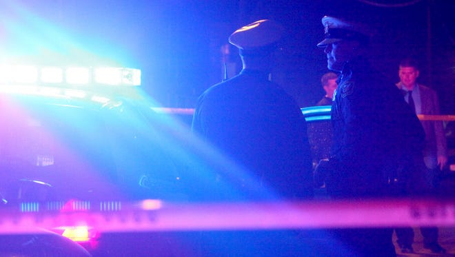 Police investigate the scene of a double shooting Friday night in Walnut Hills. Both victims are expected to survive.