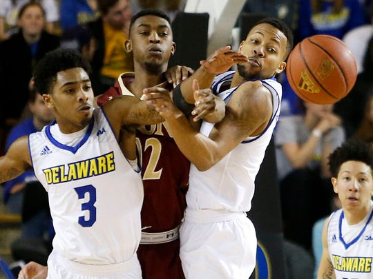 Delaware's Anthony Mosley (left) and Chivarsky Corbett follow the ball after knocking away a pass from Elon's Christian Hairston in the first half at the Bob Carpenter Center Thursday.