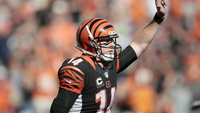 Cincinnati Bengals quarterback Andy Dalton (14) signals as he runs off the field following his rushing touchdown in the fourth quarter of the NFL Week 5 game between the Cincinnati Bengals and the Seattle Seahawks at Paul Brown Stadium in Cincinnati, on Sunday, Oct. 11, 2015. The Bengals advanced to 5-0 with a 27-24 overtime win over Seattle.