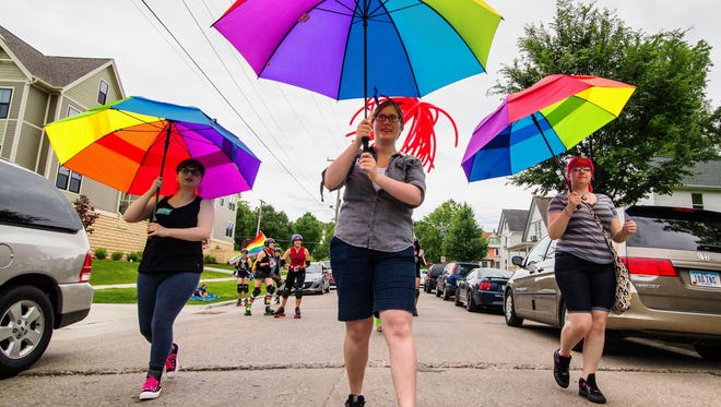 Parade participants make their way from College Green Park as part of the Iowa City Pride Parade as it made its way through downtown Iowa City on Saturday, June 21, 2014.