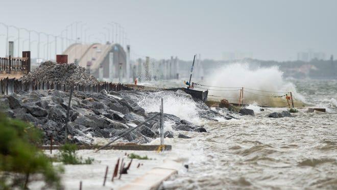Big waves crash along the causeway at the Bay Bridge after Hurricane Nate in Pensacola on Sunday, October 8, 2017.