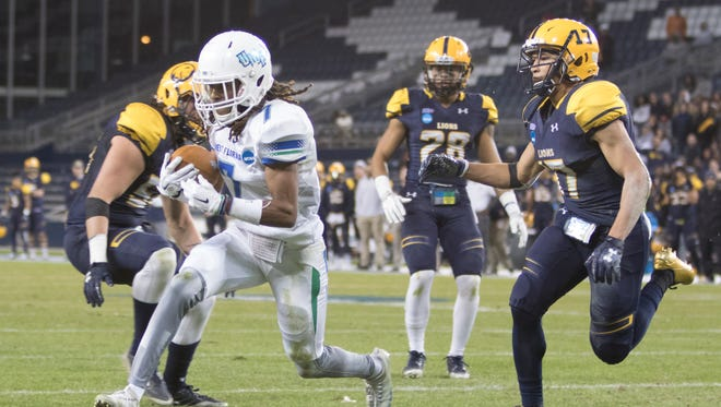 Antoine Griffin (7) takes it in for a TD during the University of West Florida vs Texas A&M - Commerce NCAA Division II National Championship football game at Children's Mercy Park in Kansas City, Kansas on Saturday, December 16, 2017.