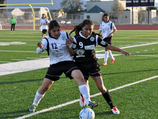 Wind forward Priscilla Ruiz gores head-to-head with Stingray Cynthia Camacho during The Salinas Californian All-Star Classic soccer game at Alisal High School on Sunday.