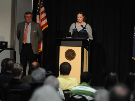 Caroline Panske and Steve Cummings of the Oshkosh Common Council recognizes the different neighborhoods at the Oshkosh State of the City meeting held at the Oshkosh Convention Center March 23, 2015.