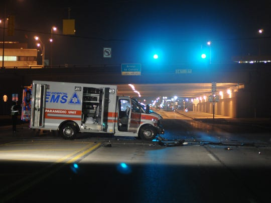 Port Huron police investigate the scene of an accident between an ambulance and passenger car Wednesday night, April 1 at Pine Grove Ave. and the exit of I-94/I-69 just south of the Blue Water Bridge.