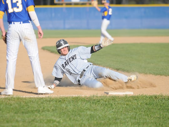 Sussex Tech's Colin Bergh slides into third for a triple.