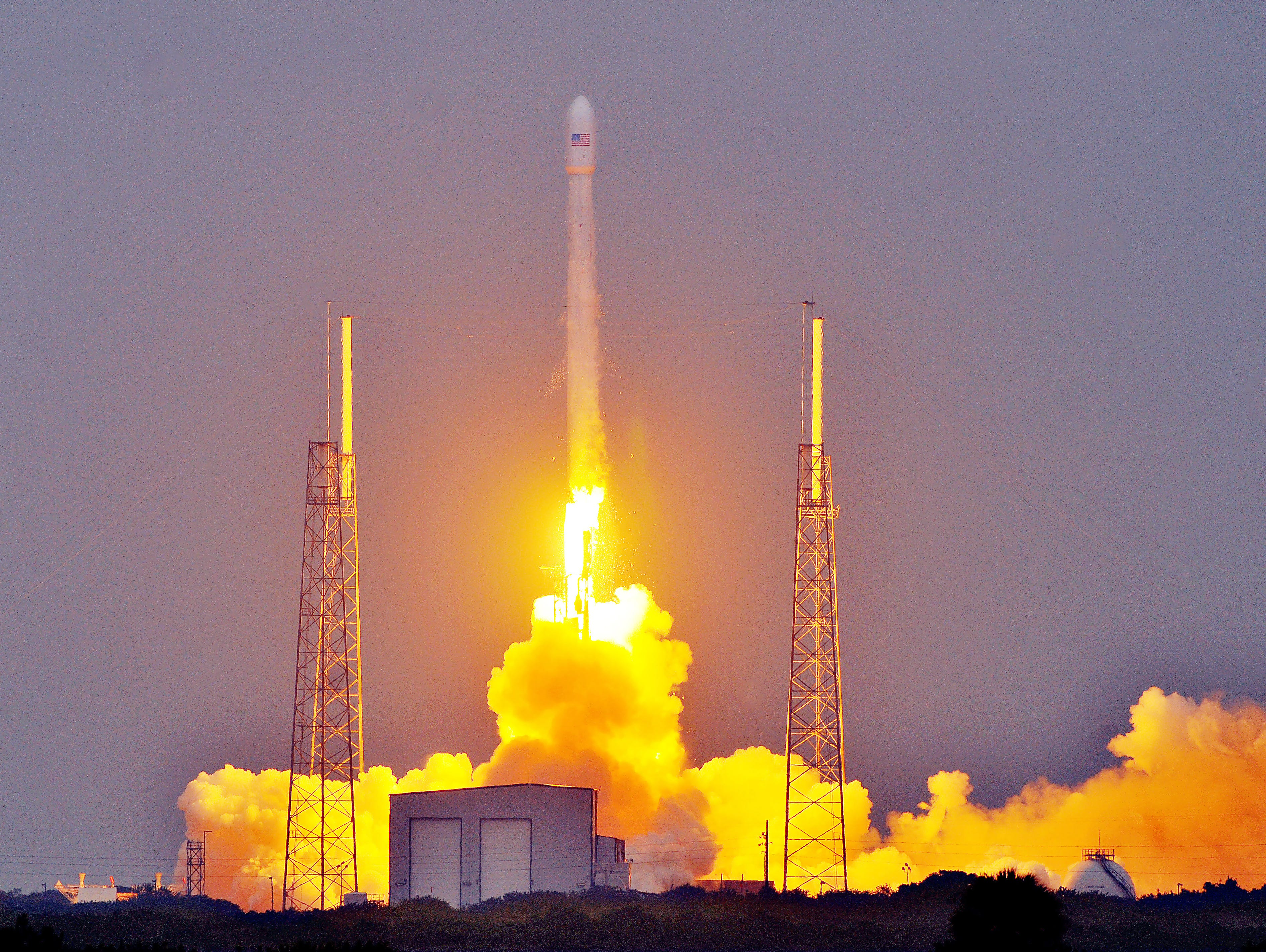 SpaceX Falcon 9 rocket carrying the first-ever Turkmenistan satellite lights up the sky over the Cape Canaveral in April