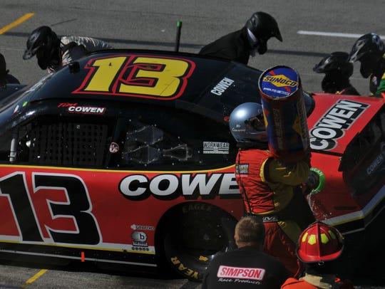 Crews refule the car of Tim Cowen of Ashland during