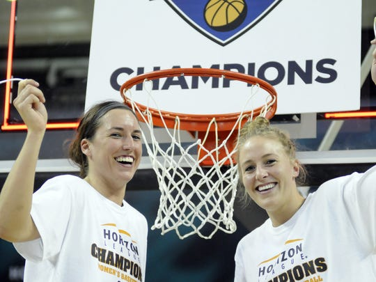 UWGB players Julie Wojta, left, and Hannah Quilling cut down the net after the Phoenix won the Horizon League women's basketball tournament at UWGB's Kress Events Center on March 11, 2012.
