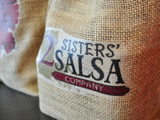 Stacey Bordelon puts together gift bags like these, which she says are popular gifts. They include 2Sisters' salsa and other products.