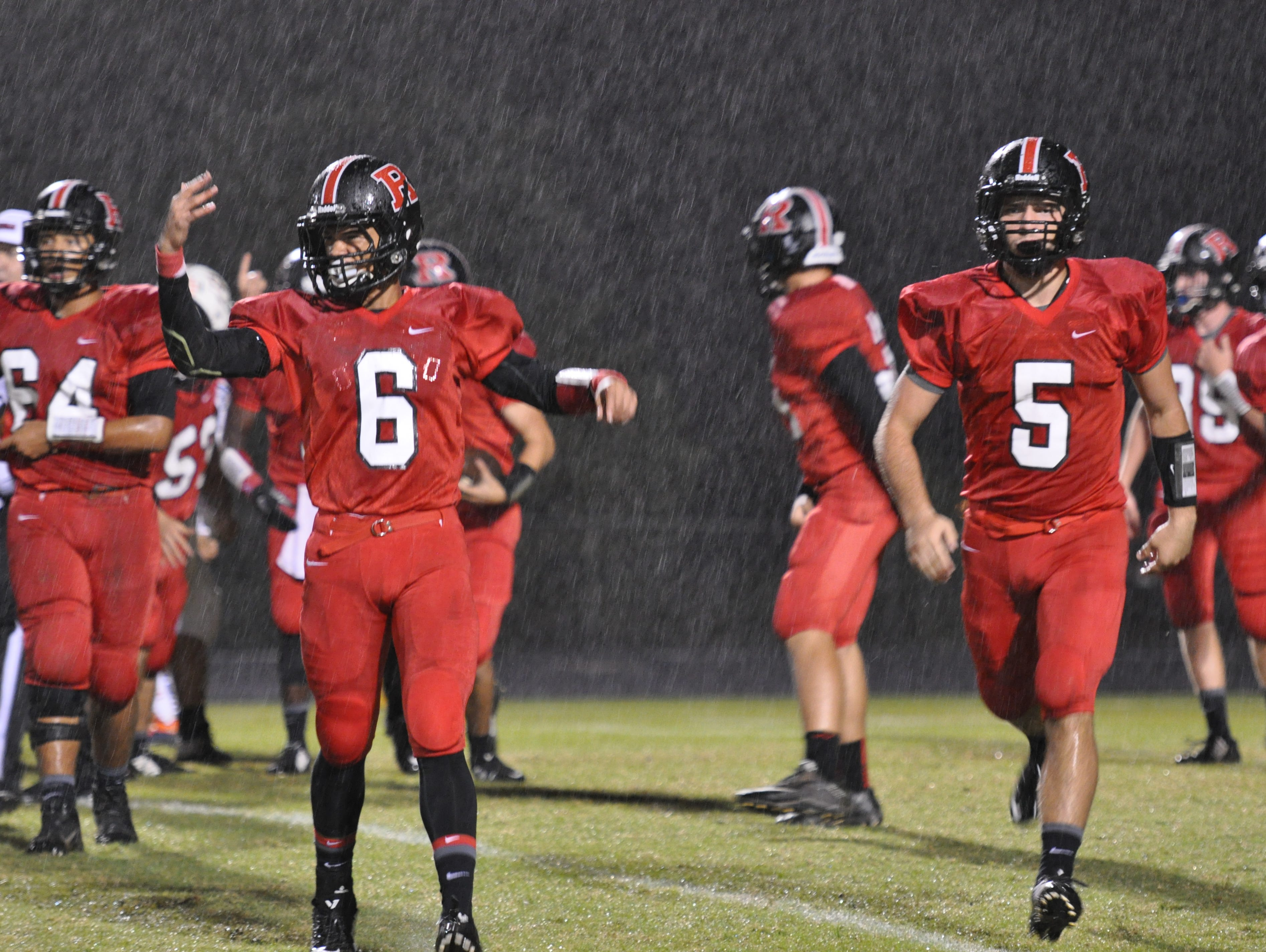 Rossview's Muncie Prater (No. 6) celebrates the Hawks recovery of a fumble early in the 12-7 homecoming win.