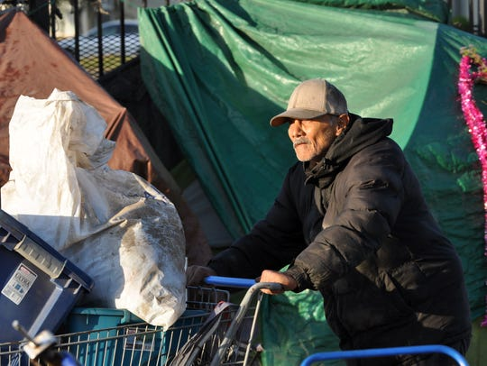 Homeless residents of Chinatown whose tents were on