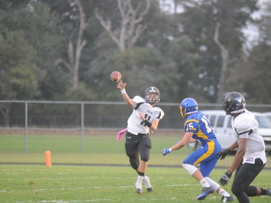 Sussex Tech's Justin Hill (11) tosses a pass downfield against Sussex Central on Monday.