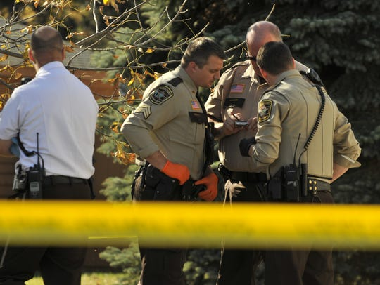 Officers with the Benton County Sheriff's Office investigate
