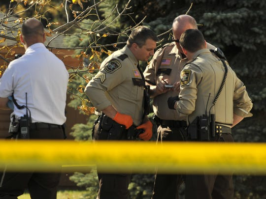 Officers with the Benton County Sheriff's Office investigate a death at a mobile home park in Rice.