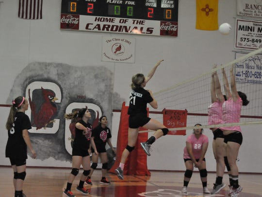 Corona's Aubrey Brandenbeger leaps to return the ball to Carrizozo at the Oct. 15 Dig Pink game.