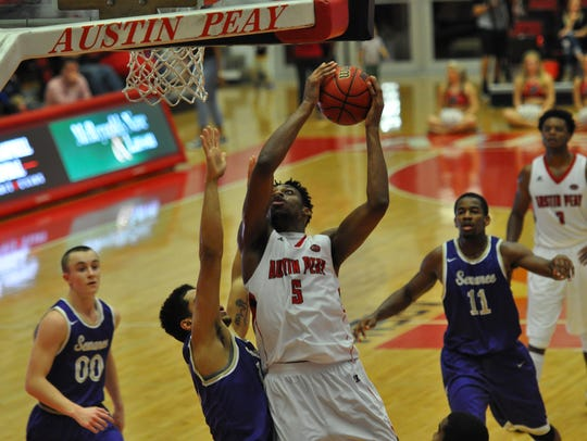 Chris Horton goes up for a basket during an exhibition