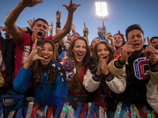 Las Cruces High School students cheer for their football team to beat Mayfield High School's team at Aggie Memorial Stadium on Friday.