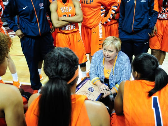 UTEP head women's basketball coach Keitha Adams talks with her team during a timeout. The Miners begin CUSA play on Friday.
