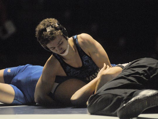 Stephen Decatur's Robert Kaminski (behind) goes for a pin against North Caroline's Ryan Bauer in the 106 weight class on Wednesday in Berlin.