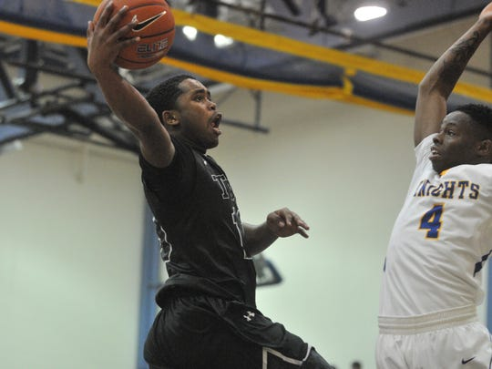 Sussex Tech's Ja'Ron Hunt-Fletcher goes for a layup while Sussex Central's Shei'Mhere Dashiell goes for the block on Friday.