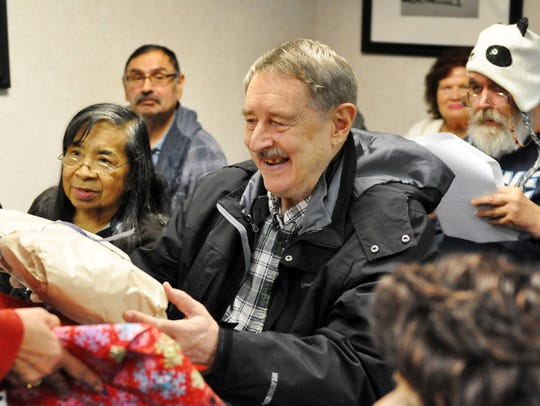 Gift-giving on Christmas Eve at at La Casa Adult Day