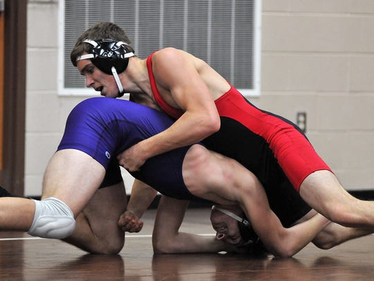Harding's Aaron Hartley wrestles with Lexington's Aidan Ammons during the 54th J.C. Gorman Wrestling Tournament at Mansfield Senior High School. Hartley is now a senior with the Presidents..