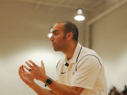Snow Hill head coach Byron Arunella tells his team