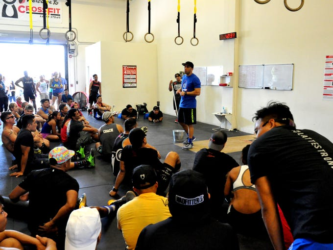 Competitors listen to CrossFit Latte Stone gym owner