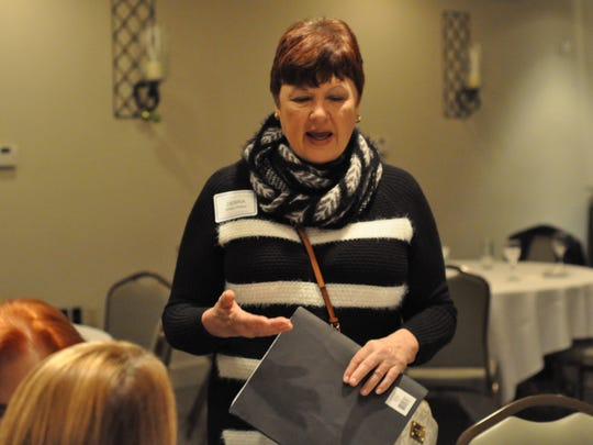 """Debi White, founder and director of P.A.W.S. of Central Louisiana, talks at Cenla's first """"100 Women Who Care"""" meeting about her nonprofit's work."""