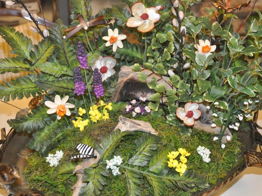 Local shells become art at bonita springs shell club show a spring garden is one of the new items this year at mightylinksfo