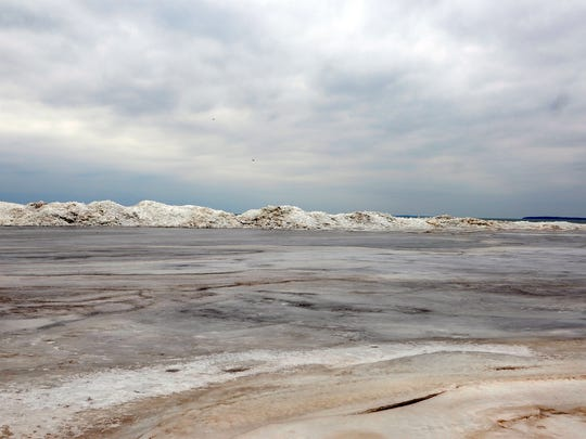 Ice piles along the shore of Port Clinton's city beach on Thursday.