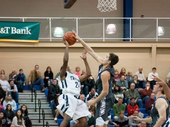 Shippensburg's Shuntan Hickman, right, lays down a block against Chambersburg's ByShawn Mincie during last year's Dunks for Drew Showcase. Both teams will return to CASHS Field House on Saturday for the ninth annual showcase.