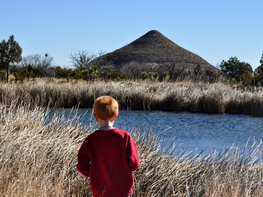 Jeremy Kirkes, 7, checked the water for signs of birds.